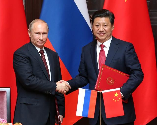 Vladimirs Putins un Si Dziņpins